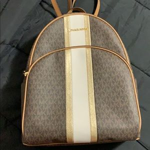 Micheal Kors Backpack and matching clutch